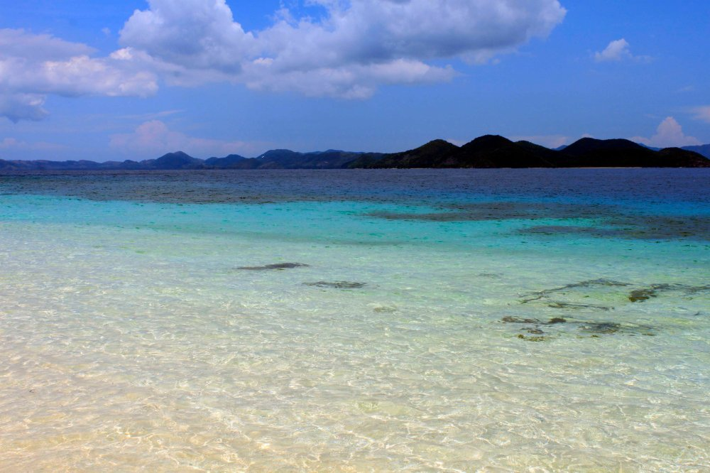 full or not, you can't turn down the invitation of the crystal clear waters of Black Island